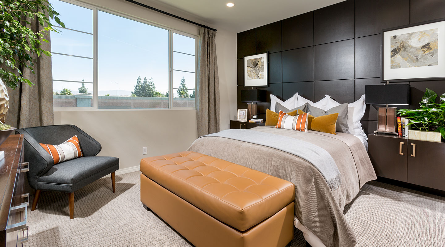 Los Alamitos Townhome Interior bedroom with large picture window and bed