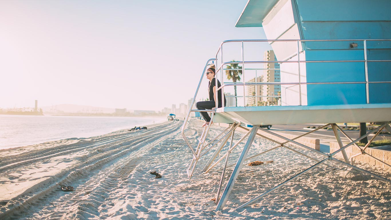Long Beach Ca Marina, woman sitting on lifeguard stand
