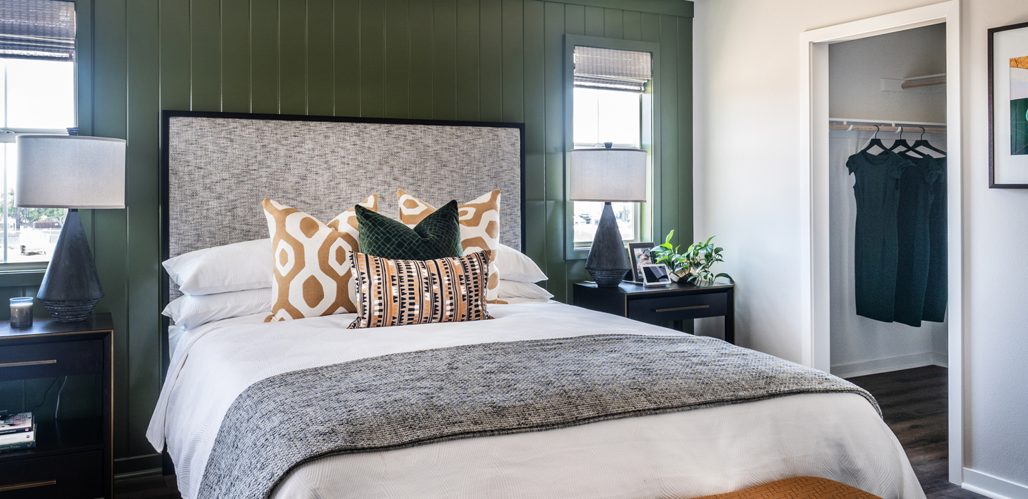 The Cottonwood - Master Bedroom with wood panel wall